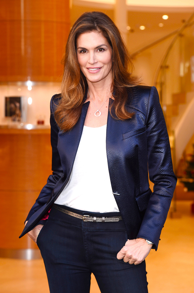 Mandatory Credit: Photo by David Fisher/REX/Shutterstock (4289082i) Cindy Crawford OMEGA boutique opening, Oxford Street, London, Britain - 10 Dec 2014 Cindy Crawford, OMEGA brand ambassador cuts the ribbon at OMEGA's new Oxford Street flagship boutique to mark the store's opening. OMEGA president Stephen Urquhart also attends